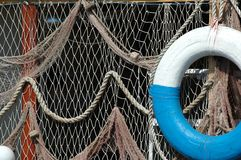 Net and lifebuoy Stock Photography