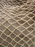 Net on linen fabric Royalty Free Stock Image