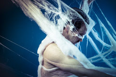 Net, naked man trapped in a huge spider web Royalty Free Stock Image
