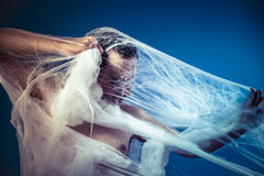Net, naked man trapped in a huge spider web Royalty Free Stock Images