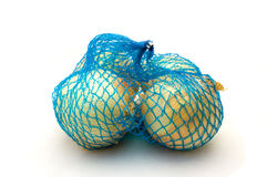 Net with onions Royalty Free Stock Photography