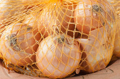 Net with onions Stock Photography