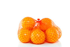 A net orange mandarines. Isolated on white background Stock Images