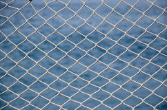 Net over blue sea Royalty Free Stock Images