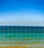 Net over blue sky and sea waves Stock Image