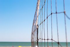 Net for volleyball close-up connected rope on the background of the shore of the sea blue clear sky beach rest summer day sport ga. Net for playing volleyball stock image