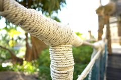 Net rope creating for wooden bridge royalty free stock photography