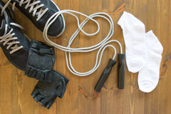 Net set for practicing jumps. Sports equipment and shoes on the floor Stock Photos