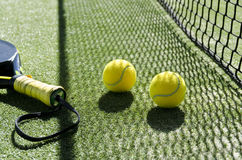 Net shadow. Paddle tennis objects and sunlight shadow Stock Image