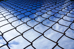 Net. Sky blue grate cloudy Royalty Free Stock Photo