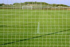 Net soccer goal football green grass field Royalty Free Stock Photos