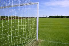 Net soccer goal football green grass field. Sunny day outdoors Royalty Free Stock Image