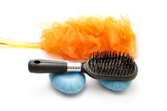 Net sponge with blue soap and Hairbrush Royalty Free Stock Photos