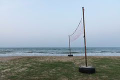 Net Volleyball on sea beach. With glommy sky stock photography