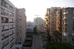 Residential buildings in Netanya, Israel at dawn. Netanya, Israel - June 8, 2017: Street view in Netanya at dawn. Residential buildings Stock Images