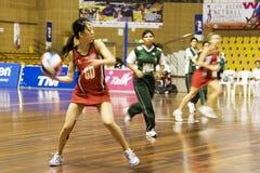 netball brouillé asiatique de championnat de 7ème action Photos libres de droits