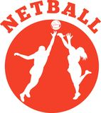 Netball player jumping ball Royalty Free Stock Photo