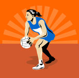 Netball player passing ball Stock Photography