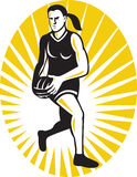 Netball player running with the ball Stock Image