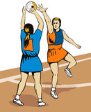 Netball player shooting Royalty Free Stock Photos