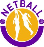 Netball player shooting ball Royalty Free Stock Photo