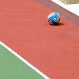 Netball and shadow. A solitary netball on the netball court Royalty Free Stock Photos