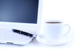 Netbook with black coffee top view Royalty Free Stock Image