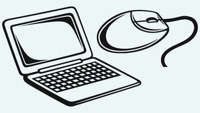 Netbook and computer mouse Stock Image