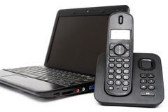 Netbook and decked telephone Royalty Free Stock Photography