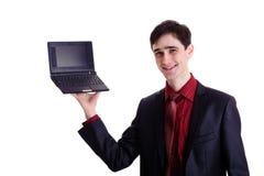 Netbook del negro del asimiento del hombre de negocios Fotos de archivo