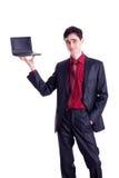 Netbook del negro del asimiento del hombre de negocios Imagenes de archivo