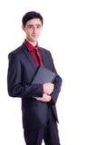 Netbook del negro del asimiento del hombre de negocios Imágenes de archivo libres de regalías