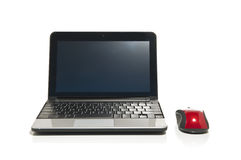 Netbook en een rode muis Royalty-vrije Stock Afbeeldingen