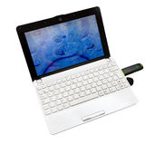 Netbook with internet key Royalty Free Stock Photography