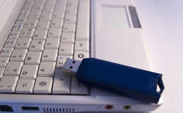 Netbook keyboard and pendrive. Close up of white netbook keybord and blue pendrive Royalty Free Stock Photo