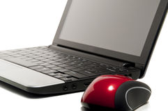 Netbook and a red mouse. Busines netbook and red mouse stock photos
