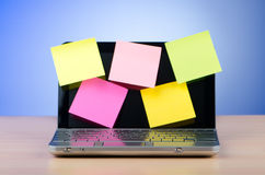 Netbook with reminder notes Stock Photo