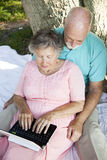Netbook Senior Couple Stock Image