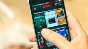 Netflix App on apple iPhone. AACHEN, GERMANY - August 2016 : Netflix app on Apple iPhone 6s. Young man is browsing the movie video library what to watch stock video footage