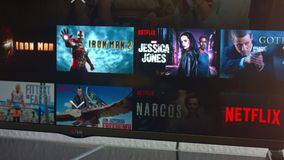 Netflix app on LG Smart TV. AACHEN, GERMANY - August 13, 2016 : Netflix app on LG Smart TV. Browsing the movie video library what new series to watch