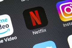 Netflix application icon on Apple iPhone X screen close-up. Netflix app icon. Netflix application. Social media network. Sankt-Petersburg, Russia, February 22 royalty free stock photo