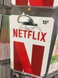 Netflix gift card. Berlin, Germany - January 12, 2018: Netflix gift card. Netflix is an American entertainment company. It specializes in and provides streaming Stock Images
