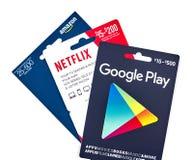 netflix, google play and amazon giftcards stock photos