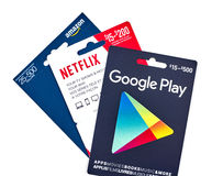 netflix, google play and amazon giftcards royalty free stock photography