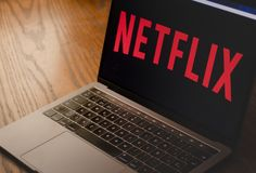 Netflix logo on laptop screen photograph stock images