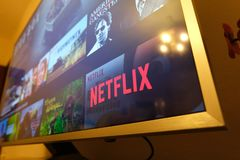 Netflix television screen with popular series choice. Movies, stock images