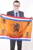 Netherland fan. Man holding flag of Netherland and smiling Royalty Free Stock Photography