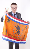 Netherland fan. Man holding flag of Netherland and showing victory sign Stock Images
