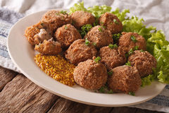 Netherlandish cuisine: meat balls Bitterballen and mustard close Stock Photos