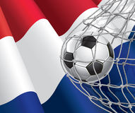 Netherlandish flag with a soccer ball. Stock Photos